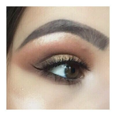Brown and bronze eye look with bold eyebrows and false eyelashes