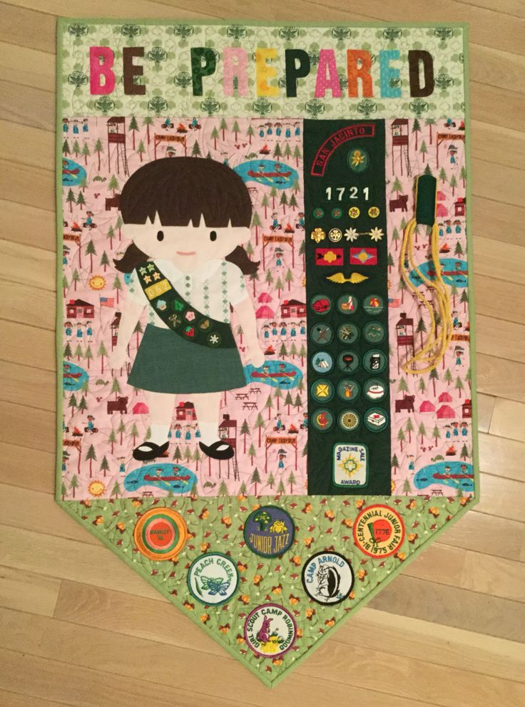 National Day Calendar guild challenge - of course this is for National Girl Scout Day.  The badges, pins and patches are all my own from when I was in scouts in the 1970s.  The scouts blouse and skirt are cut from old uniforms (although not my own).  The little girl was drafted from some clip art that I purchased on eEtsy (from DoodlesFirst) and then enlarged.  The lettering was from a free McCall's Quilting pattern called On My Honor...Be Prepared.