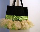 The black canvas bag measures 13 by 13 by 4 inches deep. This bag is sparkly gold & bright green with green & gold ribbon. Small gold jingle bell accents. We can put any name on the bag.  You can have us add an image to the bag too. We have gymnasts, cheerleaders, ballerinas and more. We can customize the bag for you. You can pick the colors of tutu material you want and the ribbon color. We do custom orders.