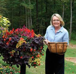 adding holes to the linings of baskets - how to get fuller planters. brilliant.Basic Baskets, Flower Planters, Must Reading, Beautiful Baskets, Fail Beautiful, Fuller Planters, Baskets Planters, Side Plants, Hanging Baskets