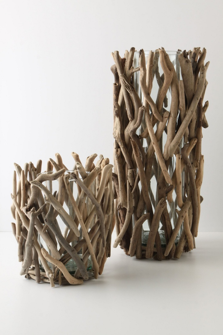 vases or candle holders surrounded by twigs...could totally do this with thrifted glass items as a gift