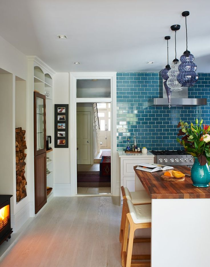 Smart Modern Kitchen with Glass Pendants and Blue-tile Splashback: