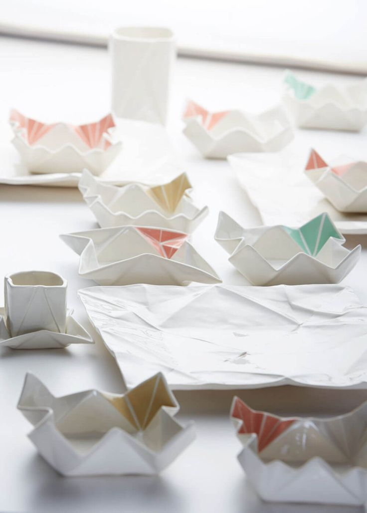 Ceramic artist from Hamburg Angelina Erhorn designs all matter of ceramic dishware that imitates the form of paper origami sheets, both wrapped and unwrapped. Her art includes plates, espresso cups, and vases with gentle creases and unusual stained geometric elements. You can check out more of her work on Instagram and Etsy.