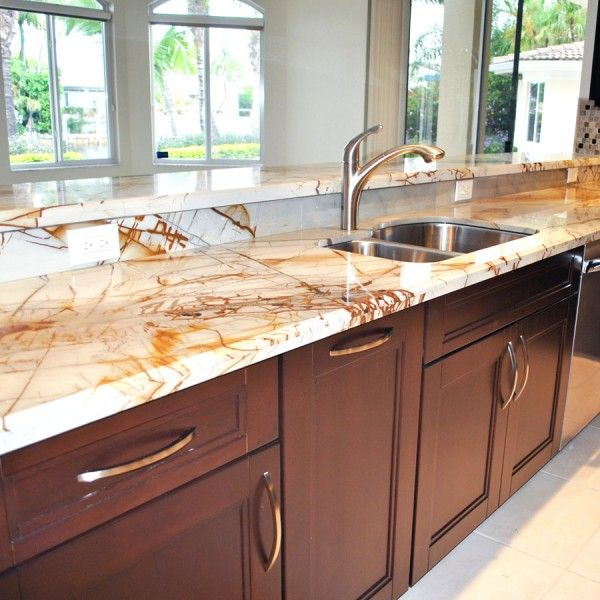 Kitchen Countertops Options: Contemporary Kitchen Featuring Roma Imperiale Quartzite Countertops. This Quartzite Has A Very
