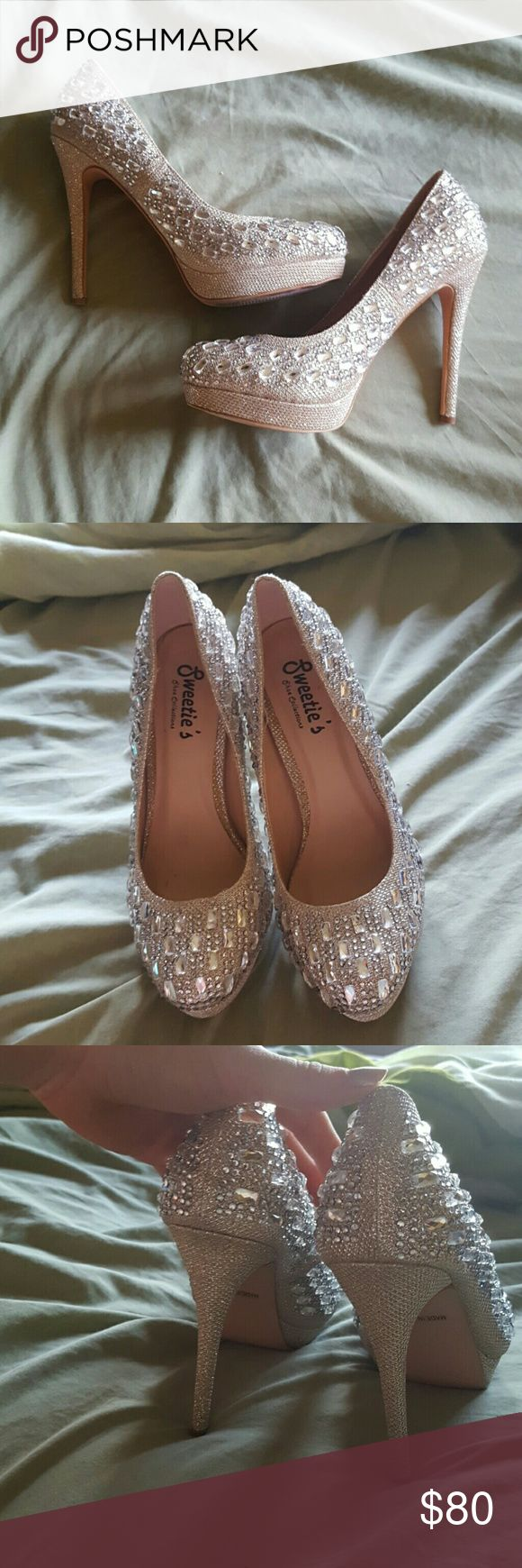 Bling heels Beautiful Cinderella like nude bling heels. Only worn once. Absolutely stunning. Size 8. Bought for 120. I can wear from a 6.5 to 7.5 but these fit like a glove even though they are an 8. Needs a new home. Price negotiable and open to trades for makeup! Shoes Heels