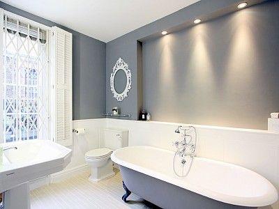 Bathroom with vintage cast iron roll top bath