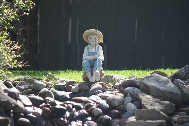Little boy pond fisherman