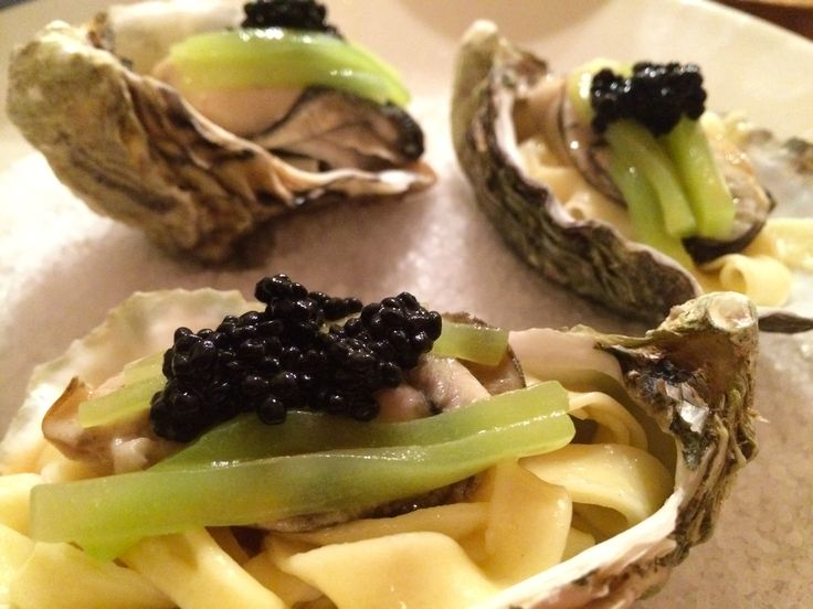 Image result for champagne poached oysters, with homemade pasta, a beurre blanc sauce, cucumbers and caviar.