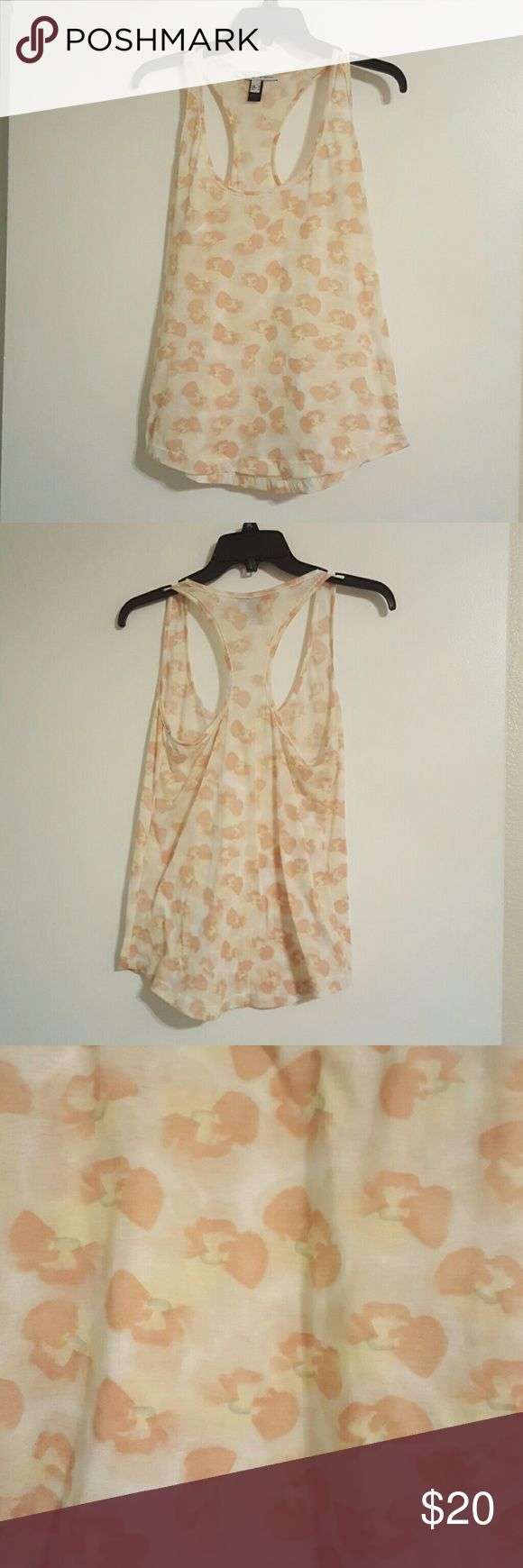 Floral tank top from MNG By Mango Sheer floral tank top in LIKE NEW condition. Size Small. Looks great alone or layered :) MNG by Mango Tops Tank Tops