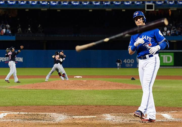 Toronto Blue Jays' Troy Tulowitzki throws his bat after making the final out in Game 5 of the American League Championship Series against the Cleveland Indians in Toronto on Oct. 19, 2016.