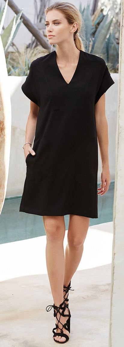 Extended sleeves modernize a classic shift dress in woven crepe fabric with concealed side pockets.