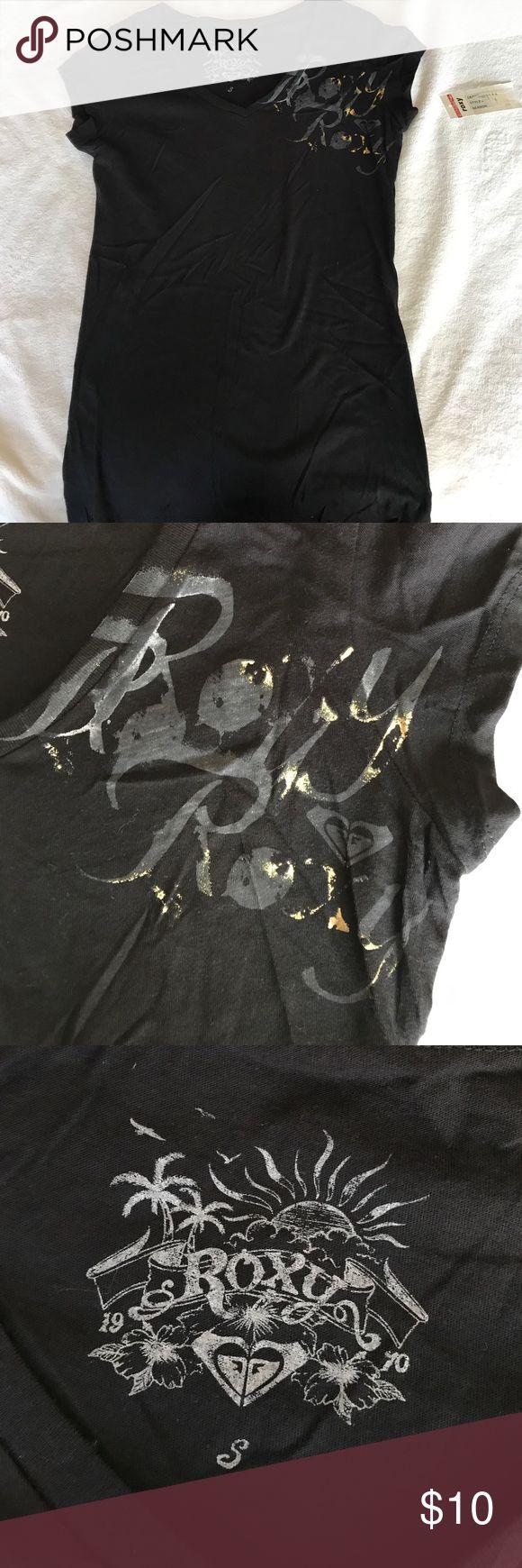 Roxy NWT black soft V-neck tshirt Roxy NWT black soft V-neck tshirt. Roxy logo lettering screen print on left shirt, has gold metallic ink hits. Tag is printed on the inside. Size juniors S. Smoke free home. Roxy Tops Tees - Short Sleeve