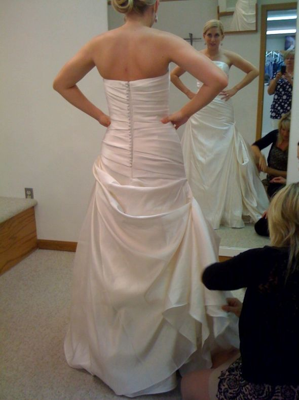 Side Bustle for Wedding Dresses with fabric that gathers to one side  My seamstress copied this for me and it turned out gorgeous!