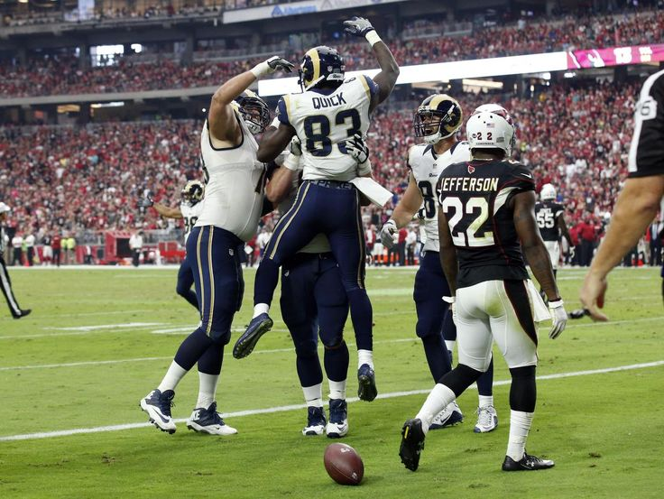 Los Angeles Rams wide receiver Brian Quick (83) celebrate his touchdown as Arizona Cardinals strong safety Tony Jefferson (22) walks away during the second half of an NFL football game, Sunday, Oct. 2, 2016, in Glendale, Ariz. (AP Photo/Ross D. Franklin)