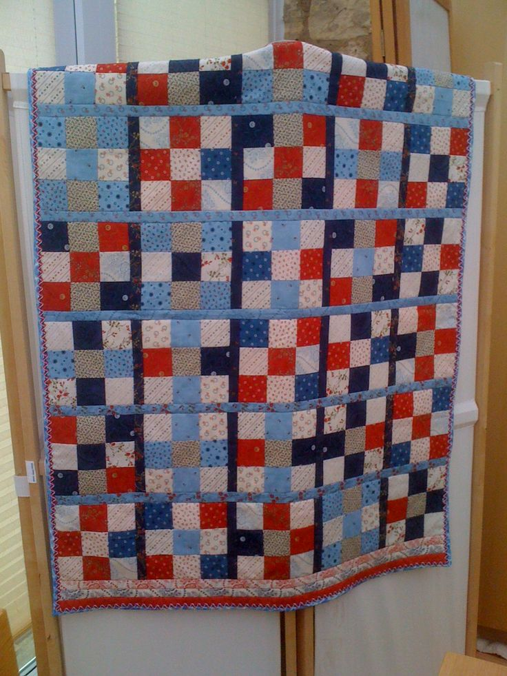 9patch quilt with fleece backing- Jubilee Marina inspired by boats moored flying red, white and blue flags. Grandsons love to snuggle up underneath.