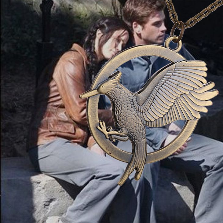 the hunger games 2 necklace catching fire bird vintage retro two sides big bronze and gold pendant for men and women wholesale