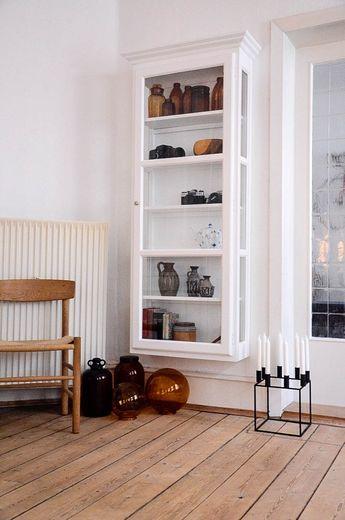 wall-mounted glass door shelving unit