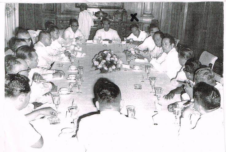 X marks the spot. That's my dad, Bernardo Rojas with an x on his head...while President Diosdado Macapagal is third from his left and apparently head of this luncheon meeting in Cavite City sometime in the 50s.