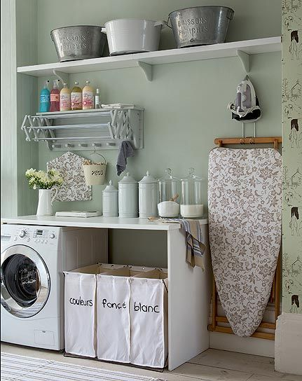 laundry room -- love the telescoping drying rack, and the wall mounted ironing board.  Also love the glass containers for detergent.  Wonder how I can make my stain cleaner, etc. far more cute?  Maybe some mod podge and coordinating papers?