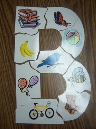 letter puzzle or use velcro on a laminated letter and stick corresponding pictures onto the letter