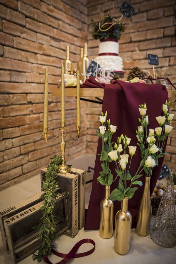 Winter wedding sweet bar with wine red and gold details.