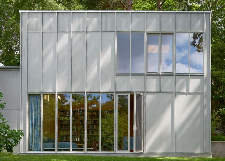 Kod Arkitekter and General Architecture s wood-panelled extension to Swedish villa
