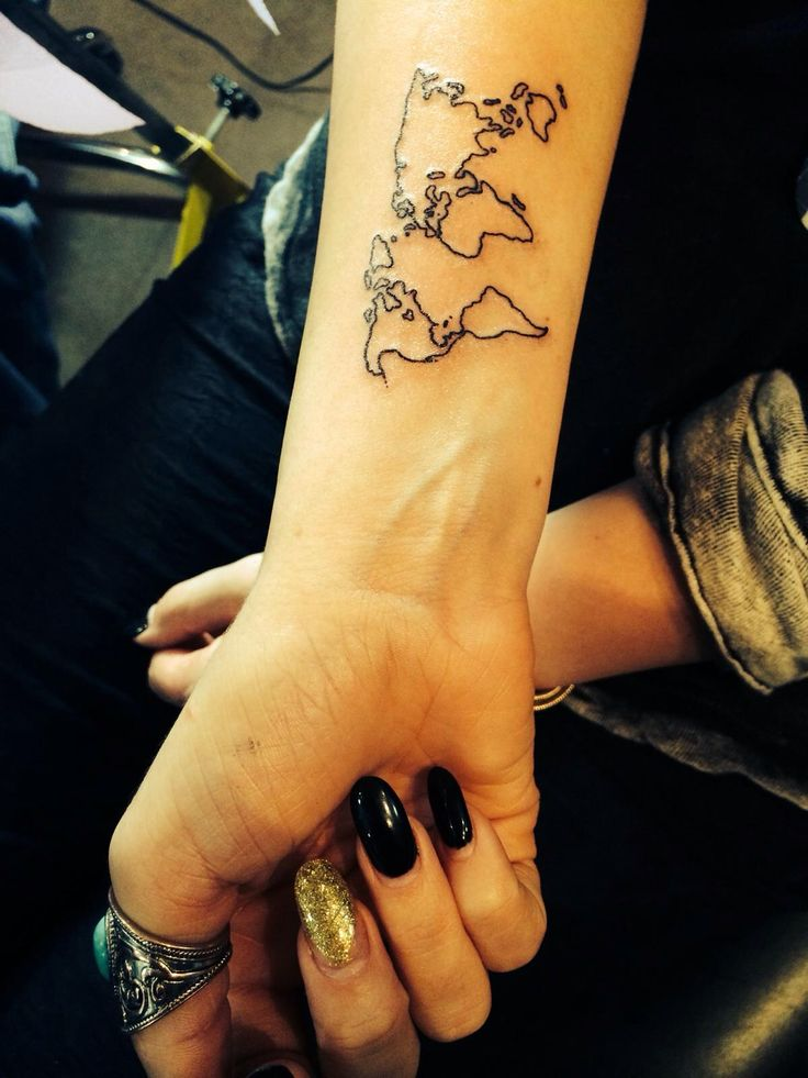 Dainty tattoo outline of the world on