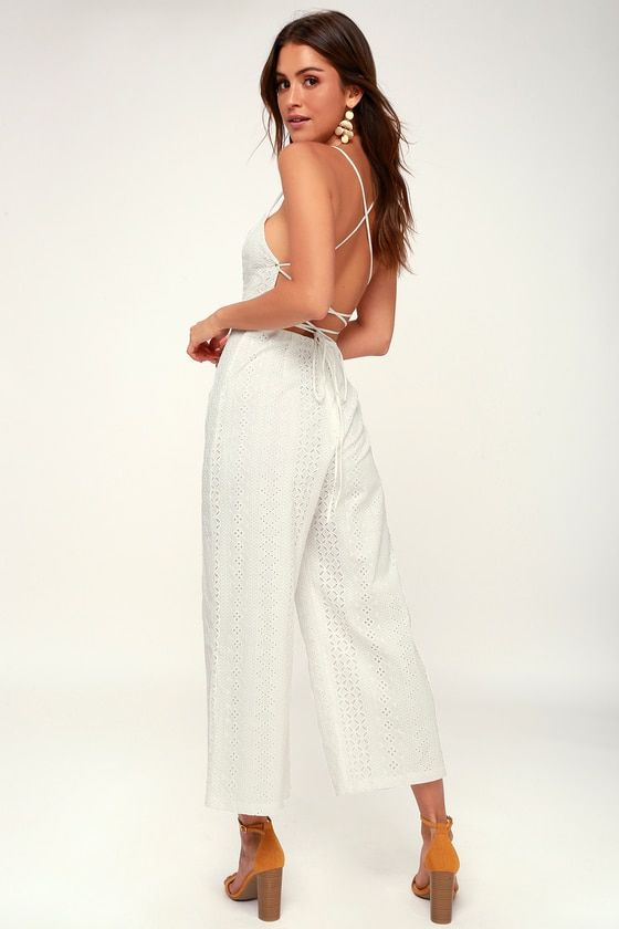 5bee0b66b774 The ASTR the Label Leighton White Lace Lace-Up Culotte Jumpsuit is a sweet  addition to any occasion! A white lace culotte jumpsuit with a lace-up open  back.