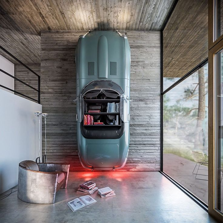 Interesting house, not a fan of the neutral color scheme but interesting design elements here. Yeah, the car on the wall is a huge one. House in Nature by Design Raum