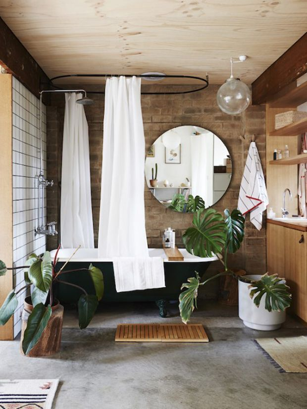 giant palms, clawfoot tub, wooden bath mat
