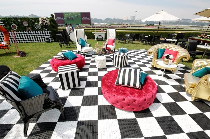 harlequin, checquered floor, quirky, gold armchair, red ottoman, stripes, black and white, pops of colour, mad hatter, alice in wonderland, topsy turvy