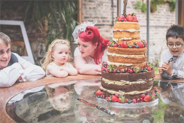 Cover your cake with strawberries for a rustic feel!