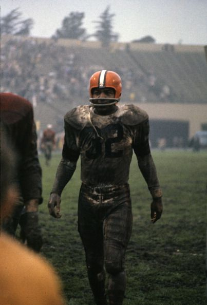 Mud-covered Jim Brown comes off the field for the Cleveland Browns.