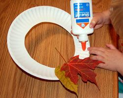 Making a fall leaf wreath with kids.