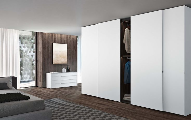 Made in Italy by Jesse Furniture the Plana sliding door wardrobe has beautifully simple sliding doors without edging profiles for a seamless wardrobe design.