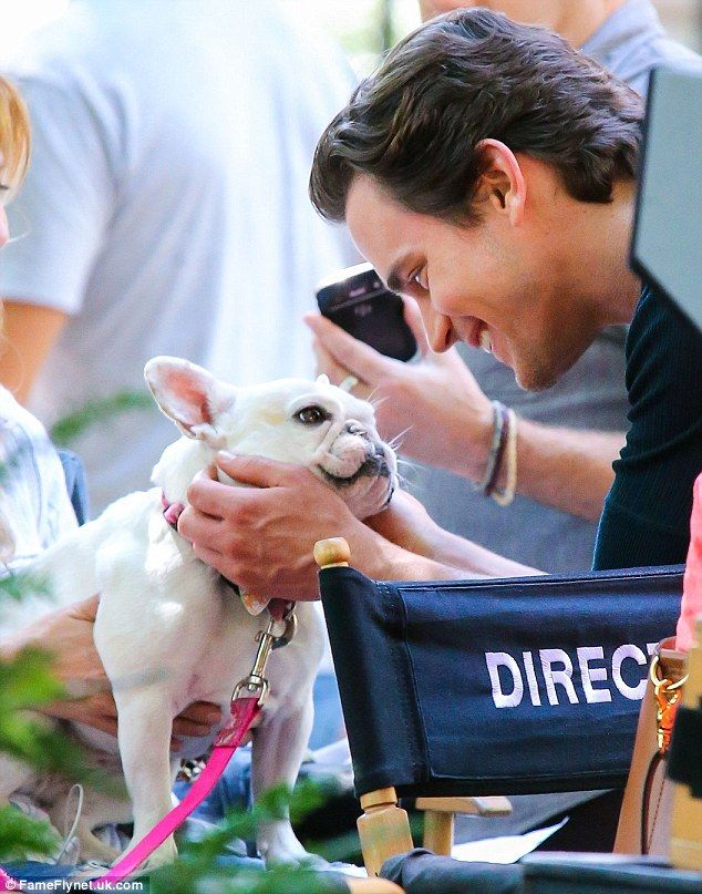 Dog and Bomer: The television hunk leaned in to give the French Bulldog a kiss as he enjoyed a break from filming