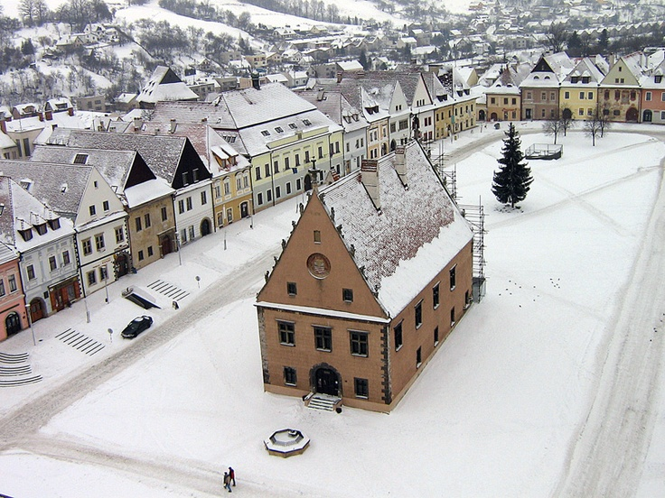 Bardejov, Slovakia.  Bardejov is a town in North-Eastern Slovakia. It is situated in the Šariš region on a floodplain terrace of the Topľa River, in the hills of the Beskyd Mountains. It exhibits numerous cultural monuments in its completely intact medieval town center.