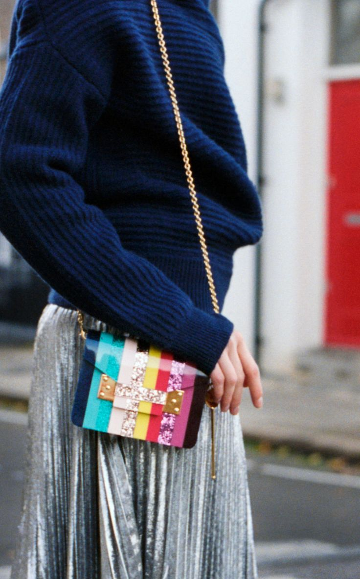 Carry our Rainbow Compton Envelope bag over your shoulder via the polished gold-plated chain strap. The perfect way to elevate an evening look or add a playful note to daytime style.