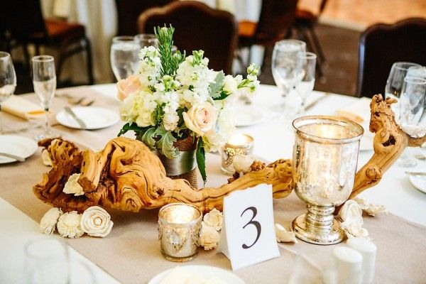 Reception centerpiece with grape wood and mercury glass   photography by http://www.thegoodness.com/