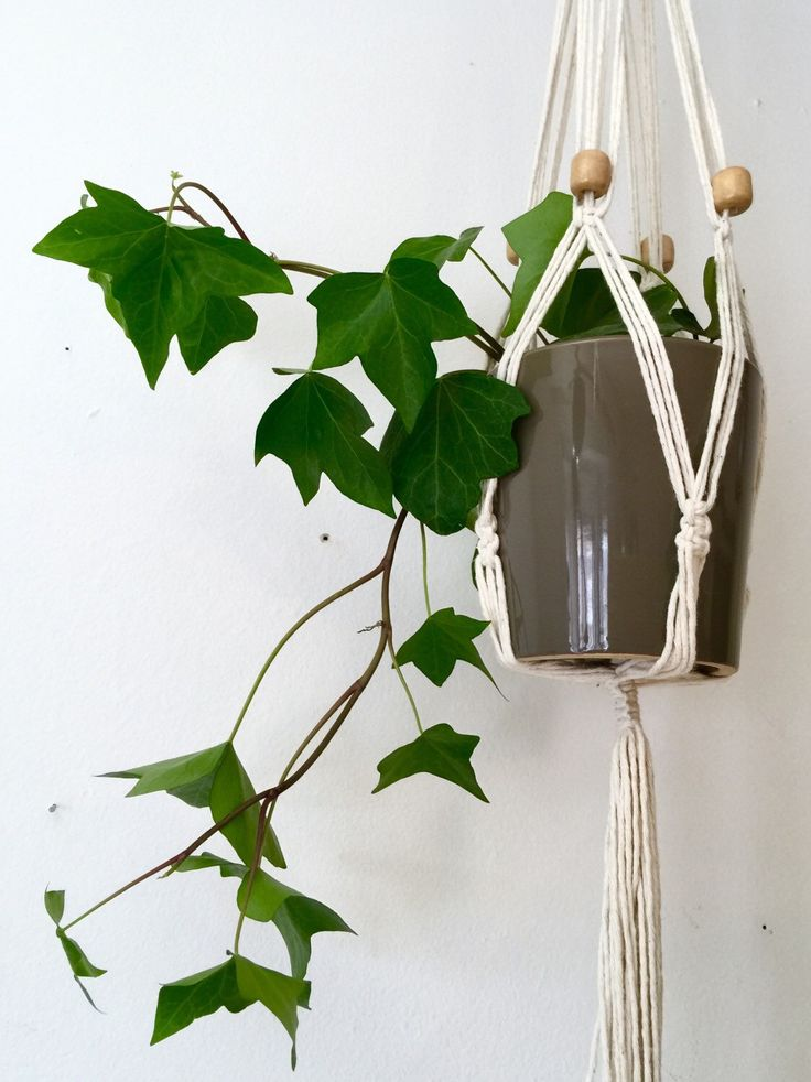 Macrame hanging planter with wood beads. Long. White macrame plant hanger, hanging planter, wall art, plant pot holder by Rowanstudios on Etsy https://www.etsy.com/ca/listing/266720355/macrame-hanging-planter-with-wood-beads