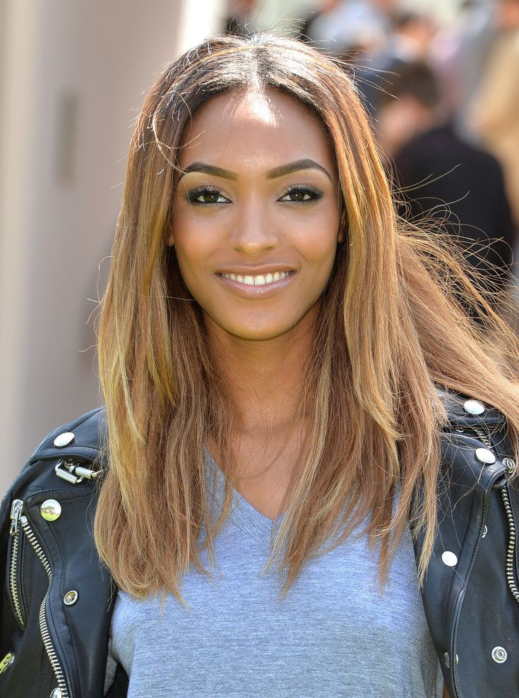 Jourdan Dunn lightened her hair to a caramel color for Summer, and she showed off her blond highlights at the Burberry men's presentation.