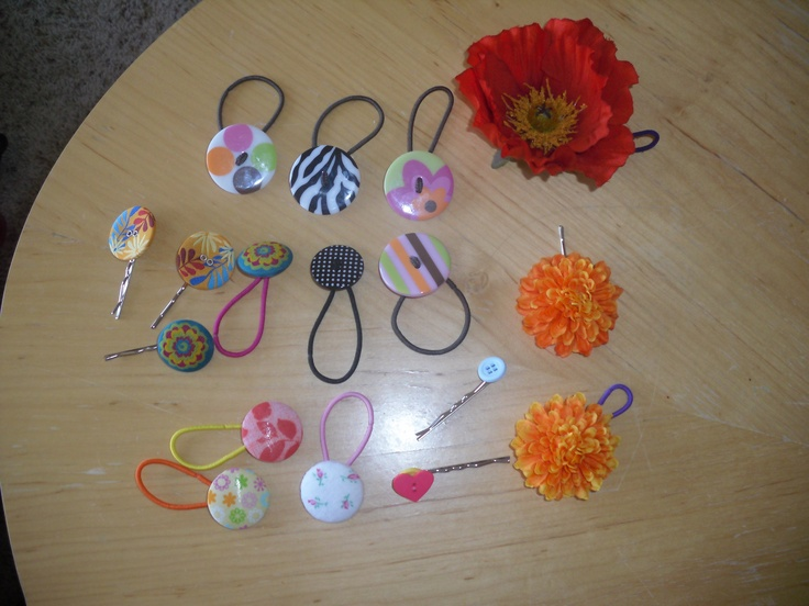 Homemade hair accessories made out of buttons, flowers, hair ties and bobby pins :]