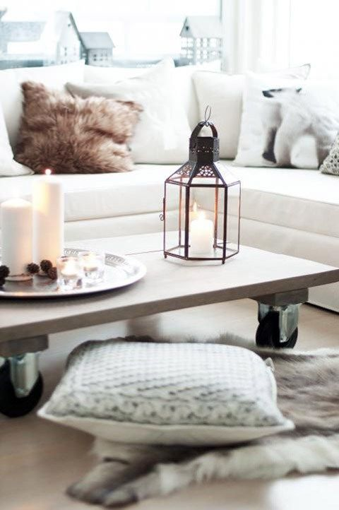 cosy-cream-sofa-in-winter-living-room-with-lantern-and-fur-rug-