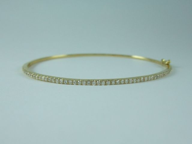 Feminine super fine hinged #Bangle in 18ct Yellow #Gold with 0.50ct #Diamonds. Price: $2250.00