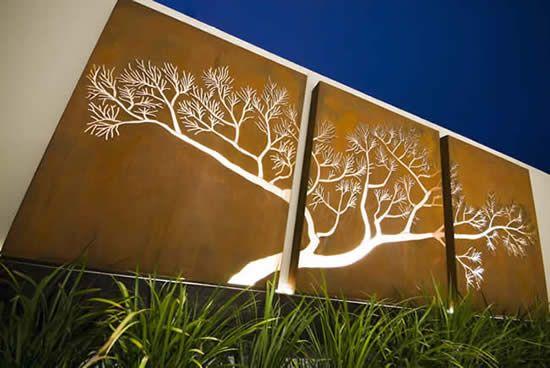 Laser cut corten tree give added interest to this wall.  Well done.