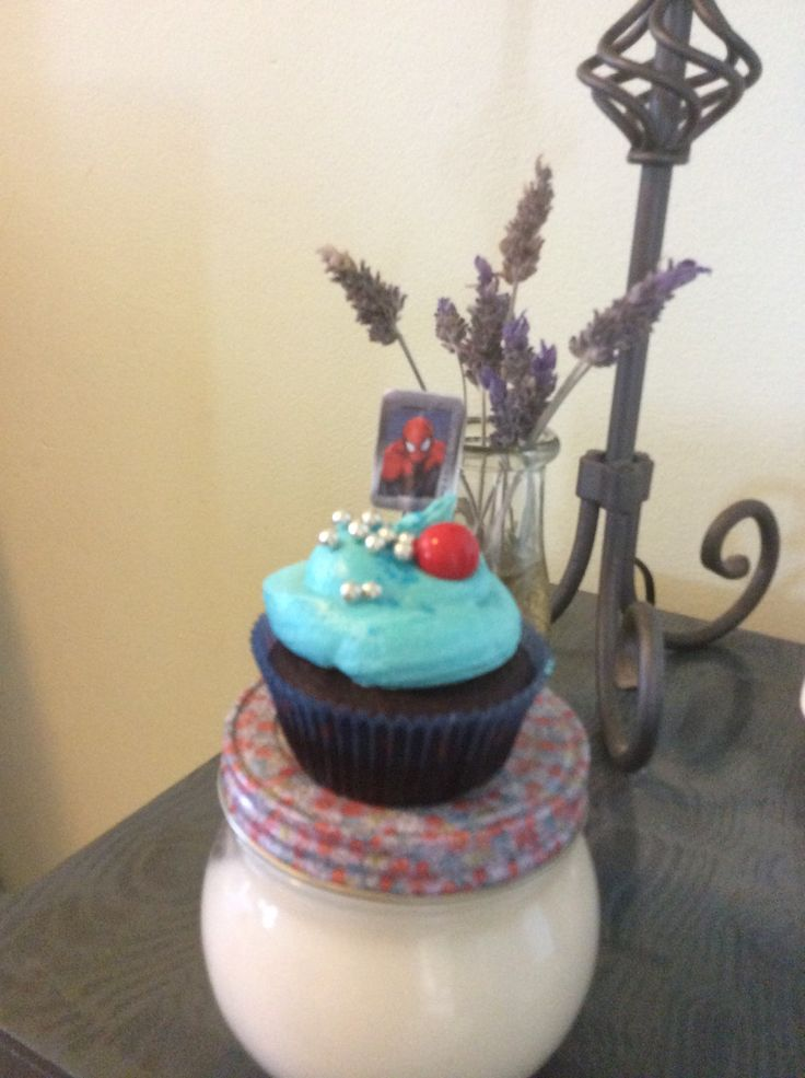 Spider-Man red velvet cupcake topped with blue buttercream icing, a jaffa & sprinkles!