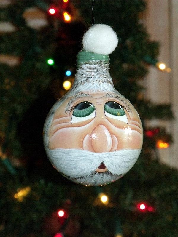 Hand Painted Green Lg. Vanity Lightbulb Santa Face Christmas Ornament.....2012 Collection. $20.00, via Etsy.