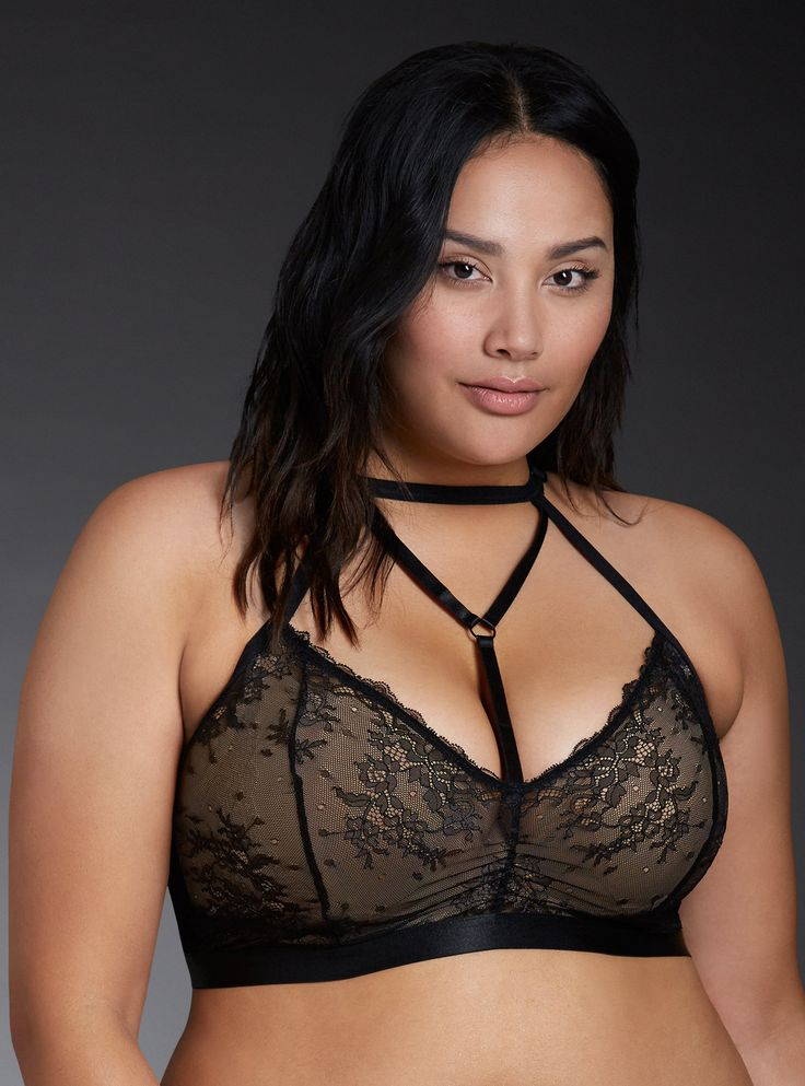 """Eyes up here!"" Start practicing this line. This wireless black lace bralette is the perfect fit thanks to a stretchy (and silky) bust band. Detailed with florals, the adjustable bralette gets a major attitude adjustment with a strappy halter neck and racerback.<div style=""text-align: justify; ""><ul><li style=""text-align: left;"">No underwires</li><li style=""text-align: left;"">Nylon/spandex</..."