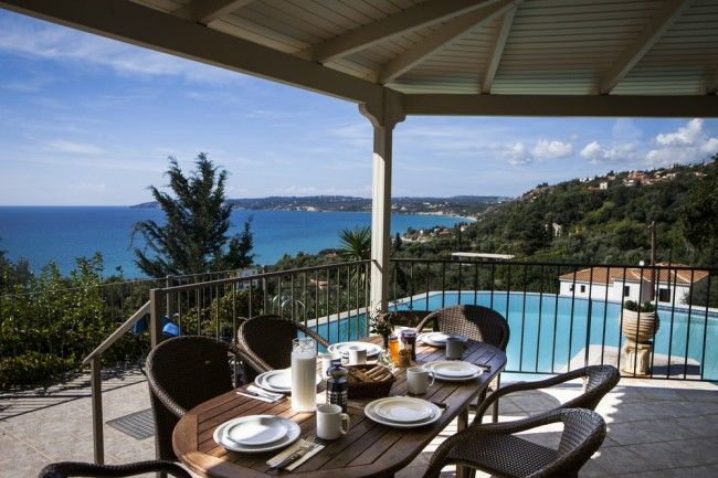 "A raised, shaded veranda for ""al fresco"" dining, not only overlooks the pool, but has stunning sea views."
