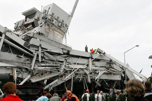 Rescue workers frantically try to find those trapped inside the Pyne Gould Corporation building. 22 Feb 2011
